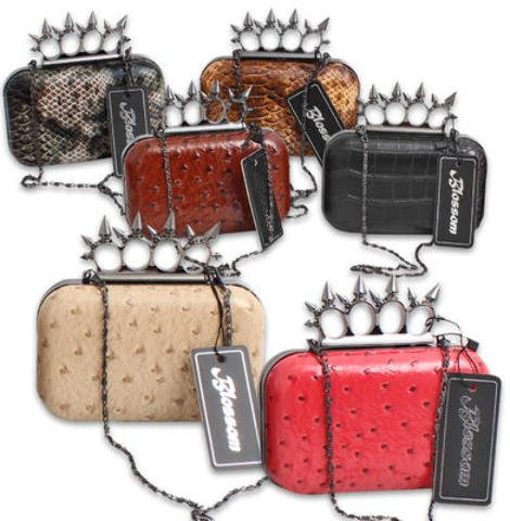 Hard Case Clutch Purse With Spiked Knuckle Ring Clasp [24 Pieces] *** Product Description: Hard Case Clutch Purse Snaps Shut And Has A Knuckle Ring With Spikes Integrated Into The Closure So The Purse Can Be Carried In The Palm And The Knuckle Ri ***